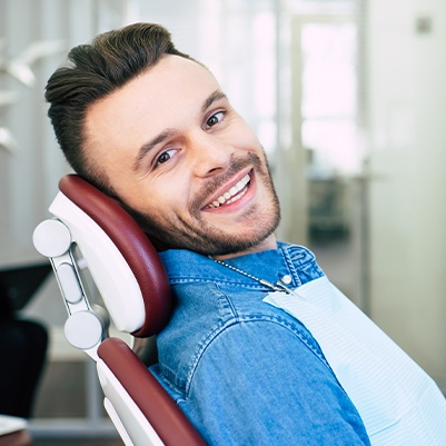 Man in dental chair during checkup