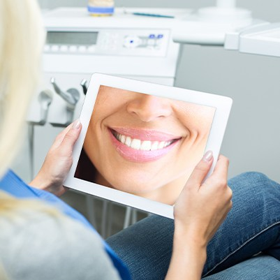 Patient looking at virtual smile design on tablet computer