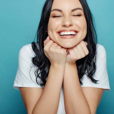 Woman receiving dental checkup to prevent the need for emergency dentistry
